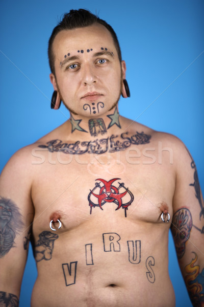 Man with tattoos and piercings. Stock photo © iofoto