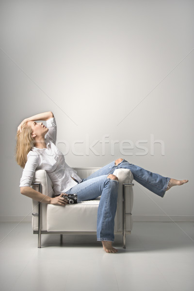 Young Woman sitting on chair. Isolated Stock photo © iofoto