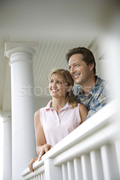 Couple porche maison souriant homme femme Photo stock © iofoto