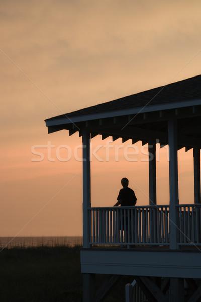 Fiú veranda naplemente tengerpart pihen sziluett Stock fotó © iofoto
