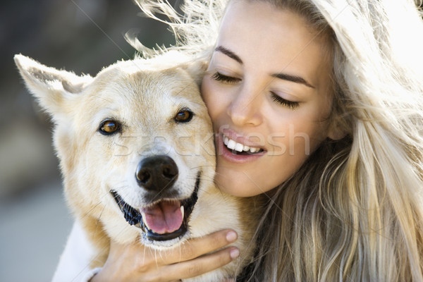 Femme chien joli blond Photo stock © iofoto