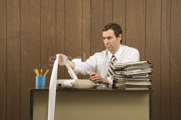 Man adding finances. Stock photo © iofoto