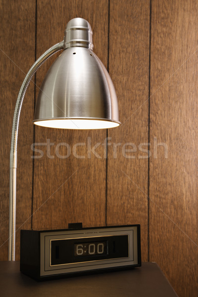 Stock photo: Retro desk lamp and clock.