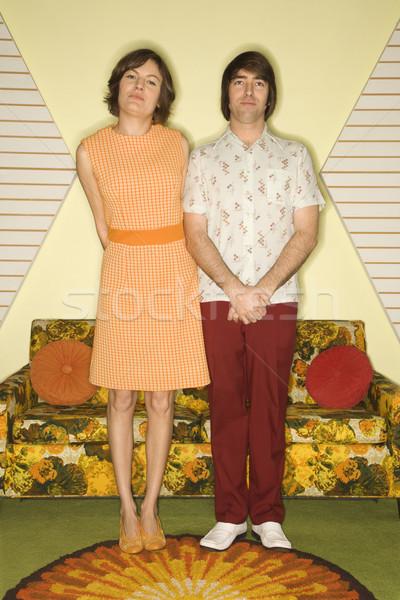 Couple standing in room. Stock photo © iofoto