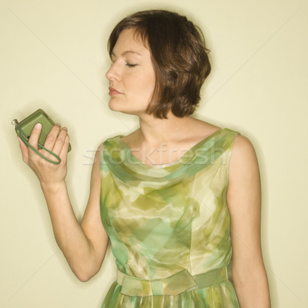 Woman with handheld radio. Stock photo © iofoto