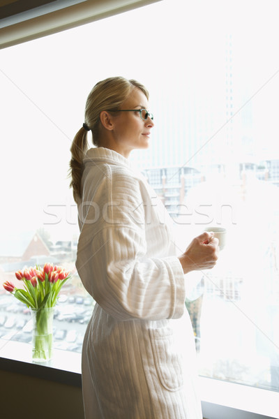Woman looking out window. Stock photo © iofoto