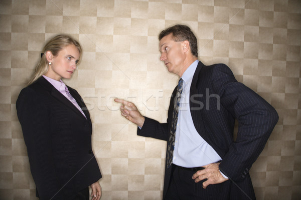Businessman Reprimanding Businesswoman Stock photo © iofoto