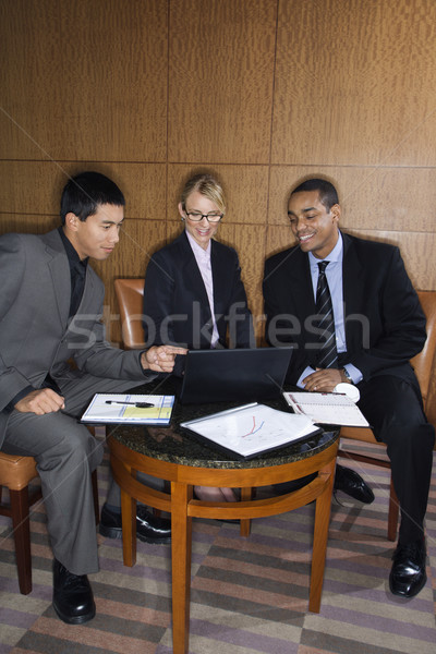 Businesspeople Looking at Laptop Stock photo © iofoto
