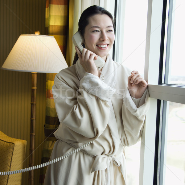Kadın telefonu yetişkin kadın bornoz konuşma telefon Stok fotoğraf © iofoto