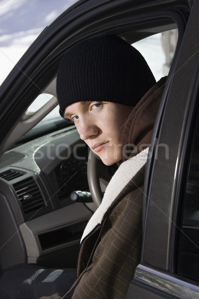 Adolescente sessão carro caucasiano masculino olhando Foto stock © iofoto