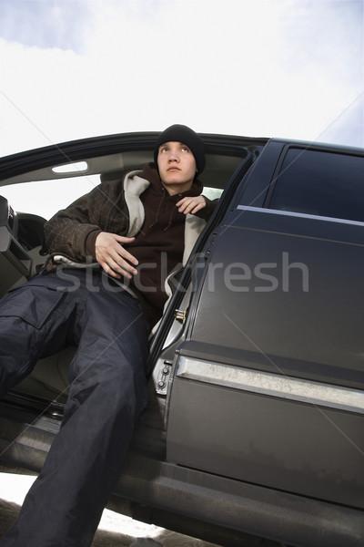 Adolescente sessão suv caucasiano masculino neve Foto stock © iofoto