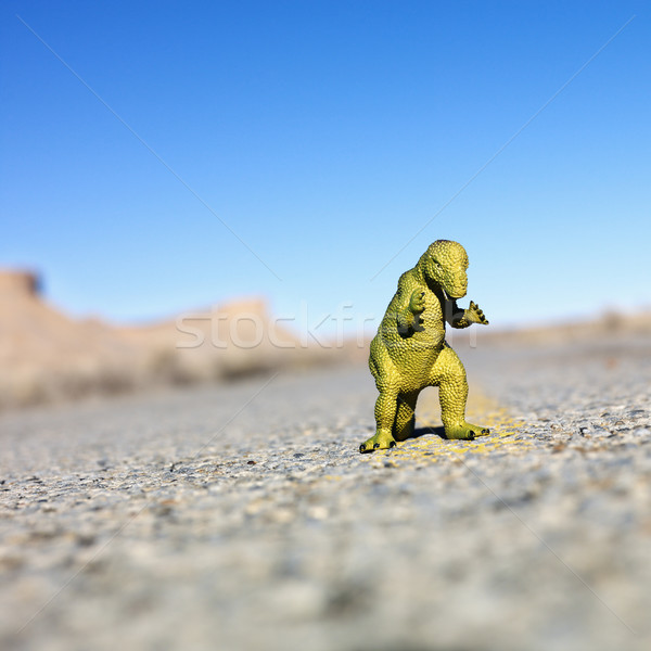 Toy dinosaur in road. Stock photo © iofoto