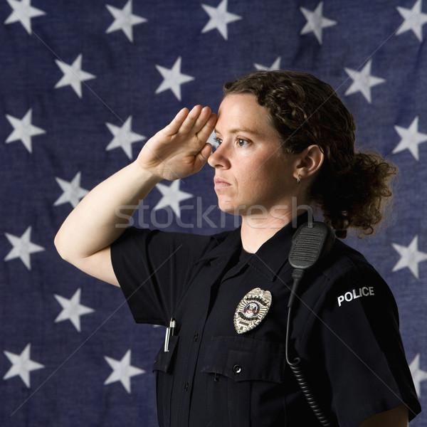Mujer policía retrato adulto caucásico bandera de Estados Unidos mujeres Foto stock © iofoto