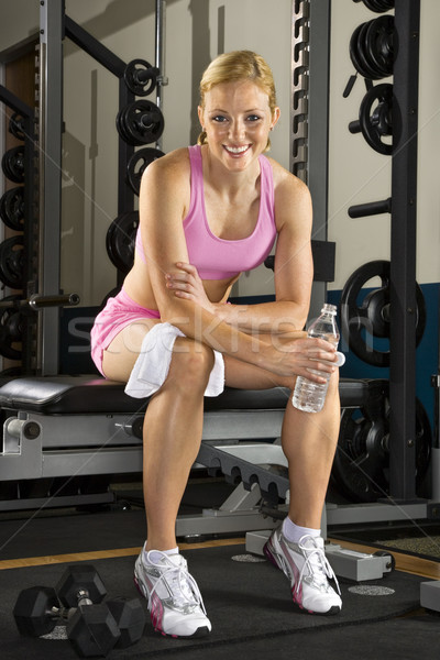 Woman on weight bench.  Stock photo © iofoto