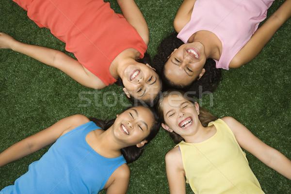 Rire filles au-dessus vue quatre herbe artificielle Photo stock © iofoto