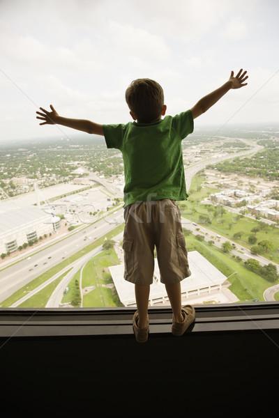 Boy at window. Stock photo © iofoto