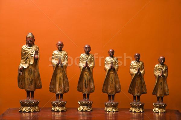Buddha and disciples. Stock photo © iofoto