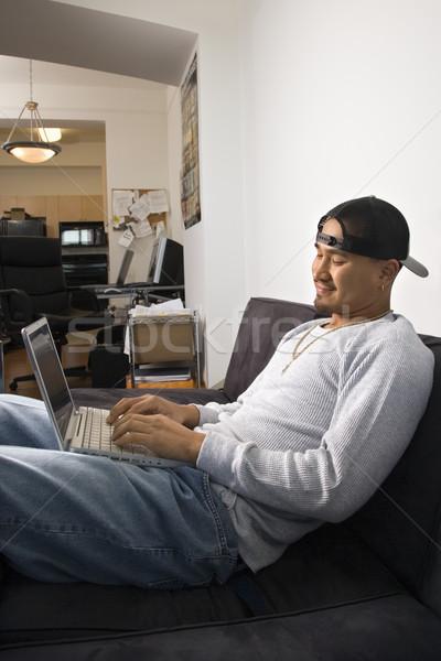 Man using laptop. Stock photo © iofoto