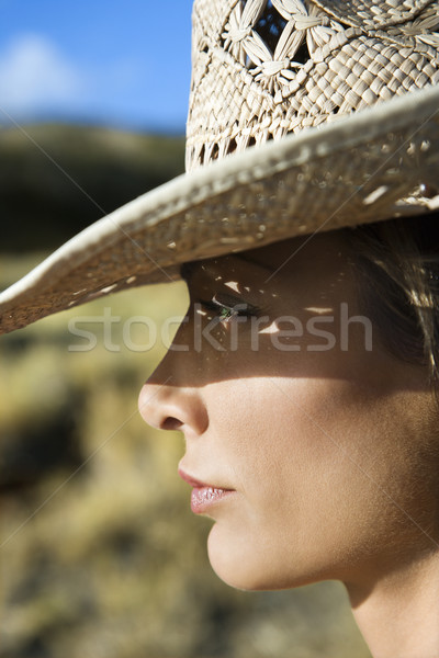 Woman in straw hat. Stock photo © iofoto