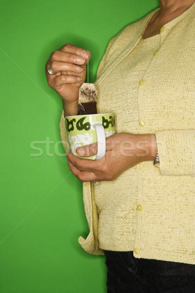 Nő tea táska afroamerikai női középkorú felnőtt Stock fotó © iofoto