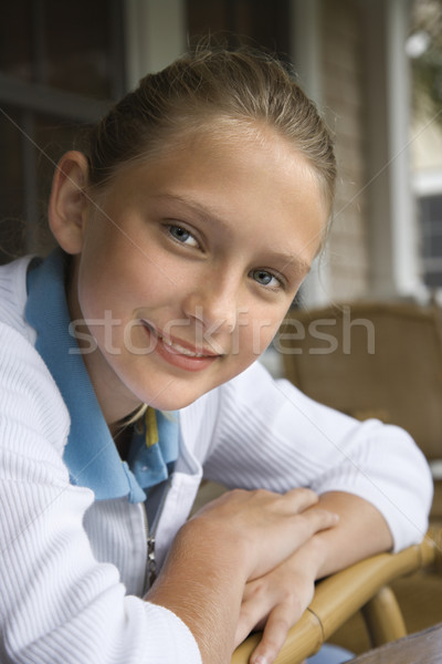 Portrait of smiling girl. Stock photo © iofoto