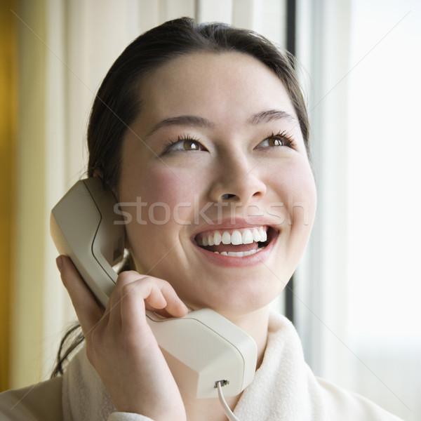 Téléphone femme adulte femme peignoir parler téléphone Photo stock © iofoto