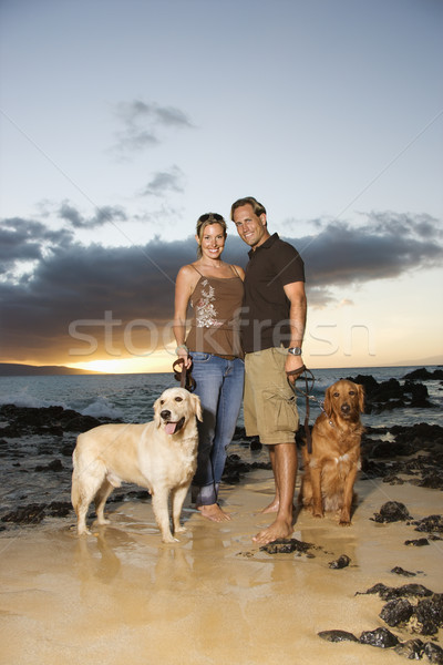 Smiling Couple With Dogs at the Beach Stock photo © iofoto