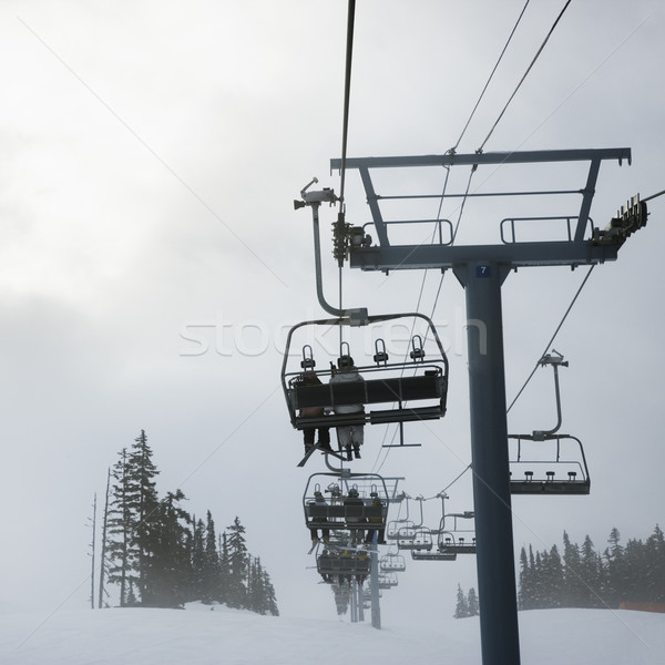Skiers on chairlift. Stock photo © iofoto
