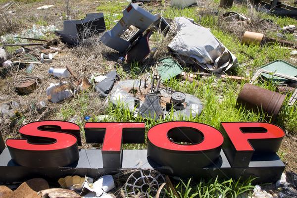 Letters spelling STOP in trashy junkyard. Stock photo © iofoto