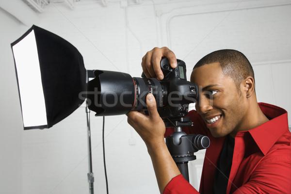 Photographer looking through camera. Stock photo © iofoto