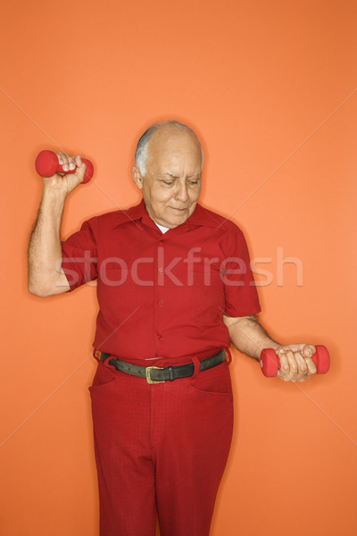 Man lifting hand weights. Stock photo © iofoto