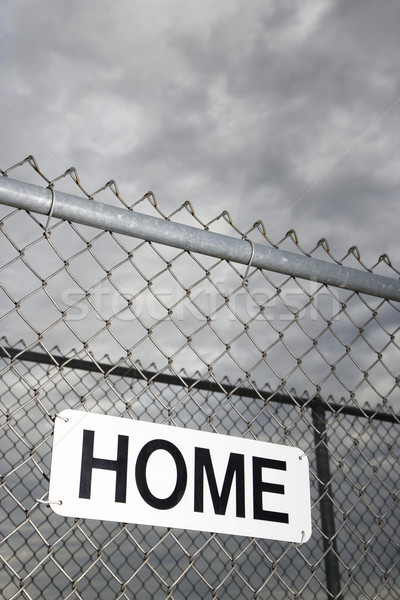 Home sign on fence. Stock photo © iofoto