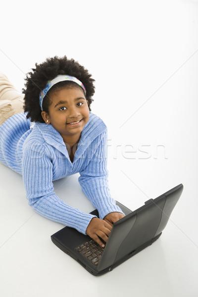 Girl on laptop. Stock photo © iofoto