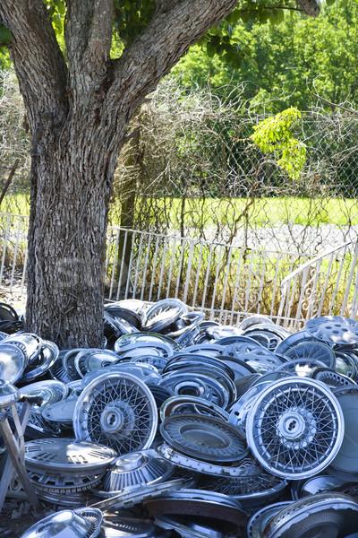 Stacks of hubcaps on ground. Stock photo © iofoto