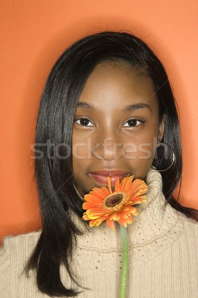 Teen girl holding flower. Stock photo © iofoto