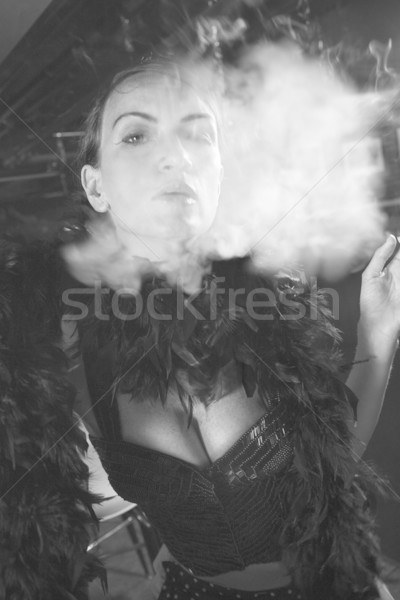 Retro female smoking. Stock photo © iofoto