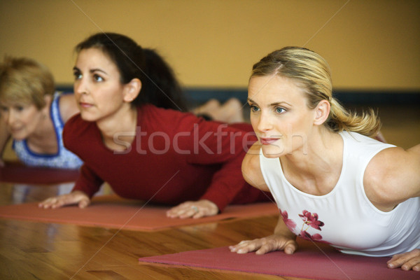 Adult females in yoga class. Stock photo © iofoto