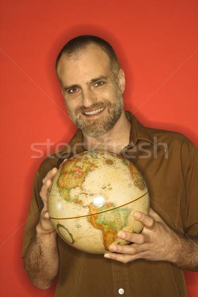 Man holding globe. Stock photo © iofoto