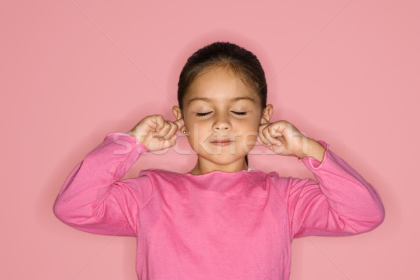 Girl with fingers in ears. Stock photo © iofoto