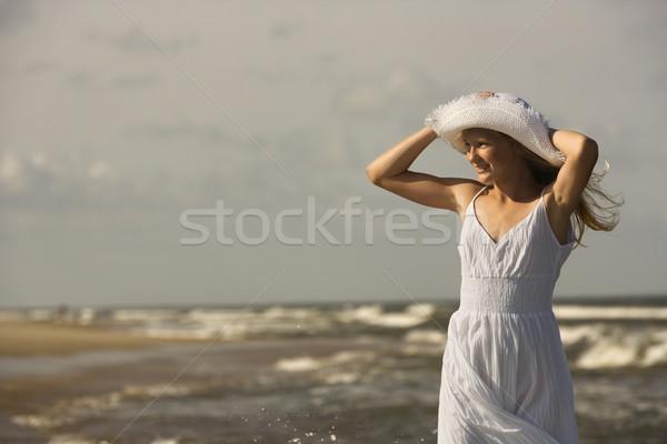 Girl on windy beach. Stock photo © iofoto