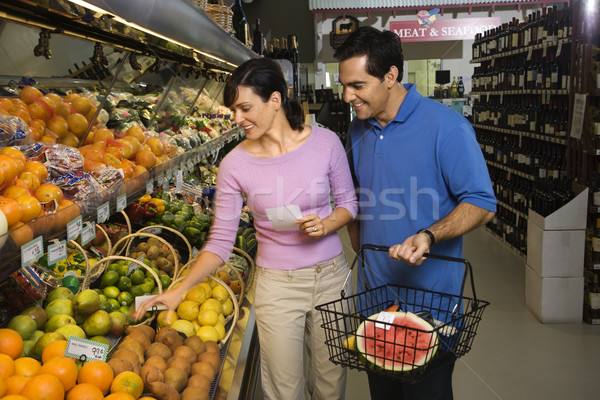 Couple épicerie Shopping fruits alimentaire Photo stock © iofoto