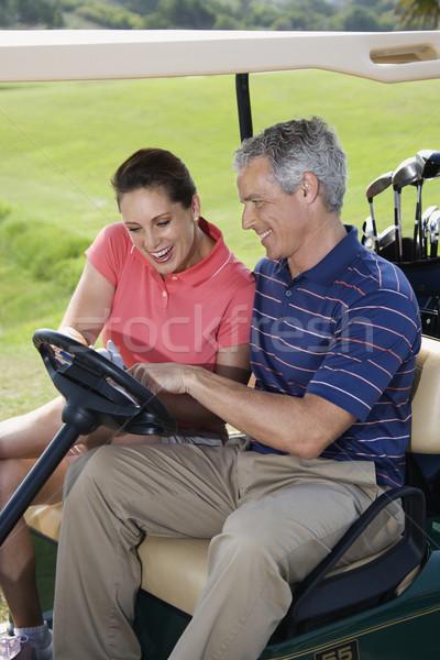 Couple in golf cart. Stock photo © iofoto