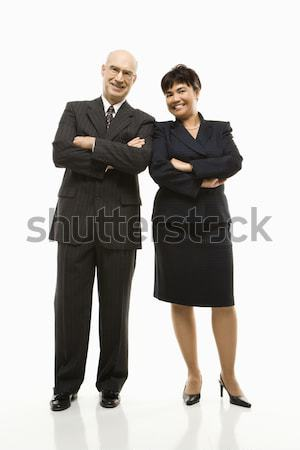 Smiling businessman and woman. Stock photo © iofoto