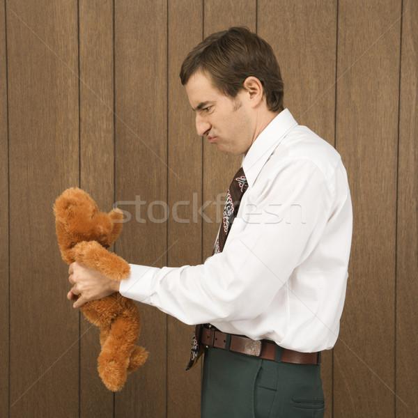 Man with teddy bear. Stock photo © iofoto