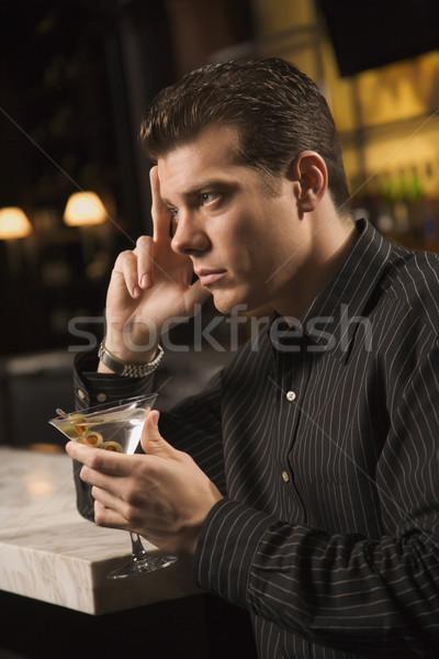 Hombre potable martini vista lateral adulto caucásico Foto stock © iofoto