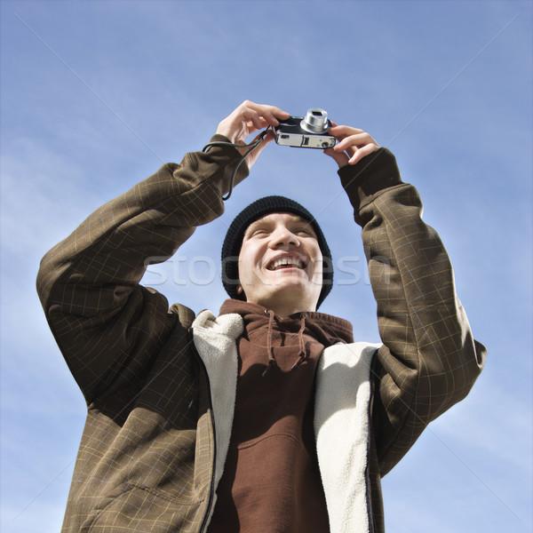 Teen taking picture. Stock photo © iofoto