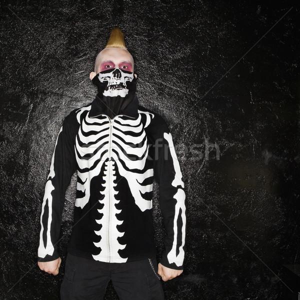 Punk with skeleton costume. Stock photo © iofoto
