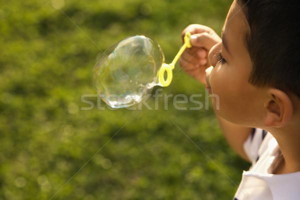 Fiatal srác buborékfújás kívül zöld jókedv szín Stock fotó © iofoto