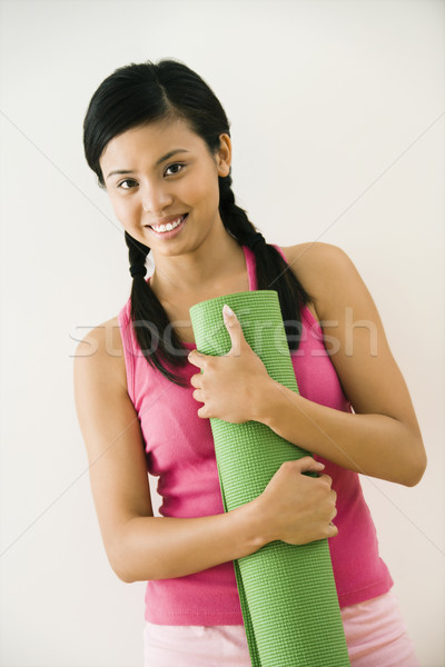 Woman with exercise mat Stock photo © iofoto