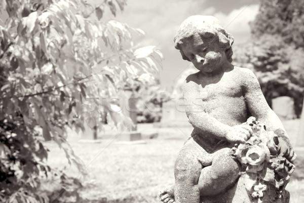 Infrared cherub statue at graveyard. Stock photo © iofoto
